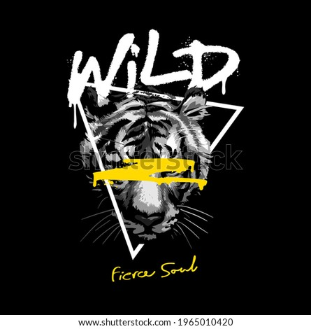 wild fierce soul spray painted slogan with black and white tiger head in triangle frame on black background Stock photo ©