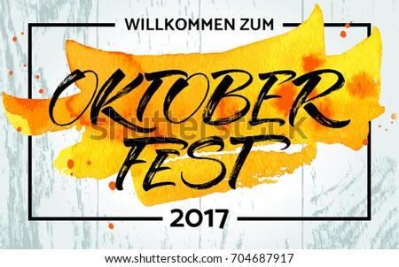 Willkommen zum Oktoberfest (German) / Welcome to Oktoberfest (English) lettering. Handwritten modern calligraphy, brush painted letters. Template for banner, poster, merchandising or photo overlay.