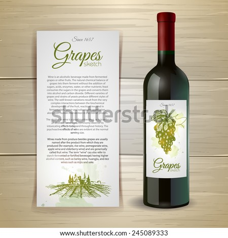 Wine bottle with label. Wine and grapes