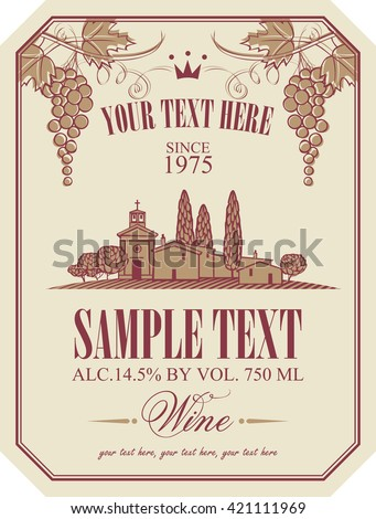 wine label with a landscape of vineyards and Italian village and a bunch of grapes