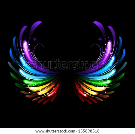 Stock Photo Wings, painted with colorful sparkles on black background.