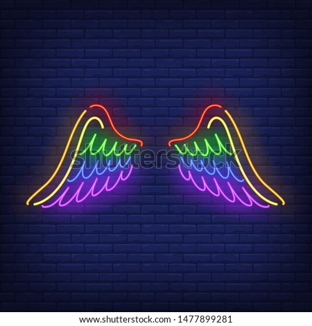 Wings with LGBT colors neon sign. Freedom, tolerance, discrimination design. Night bright neon sign, colorful billboard, light banner. Vector illustration in neon style.