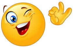 Winking emoticon showing ok sign
