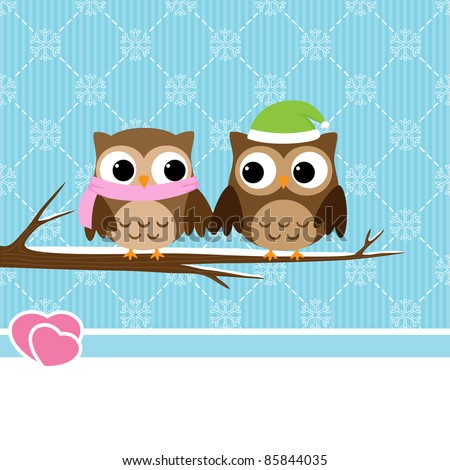 Winter background with couple of owls sitting on branch
