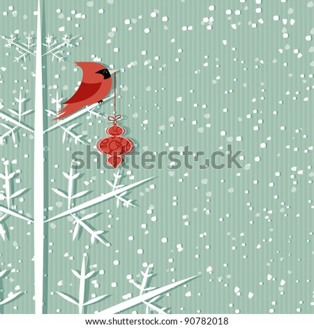 Winter background with red cardinal holding christmas decoration