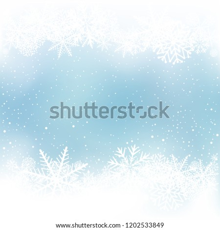 Winter blue sky background with snow frame. Frosty close-up wintry snowflakes. Ice shape pattern template. Christmas holiday decoration backdrop