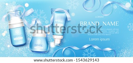 Winter cosmetic tubes and cream jar on blue background with snowflakes and ribbons. Cold season moisturizing beauty cosmetics product bottles set mock up line. Realistic 3d vector illustration, banner