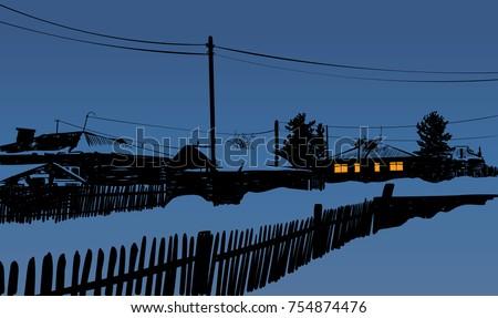 winter evening in village in