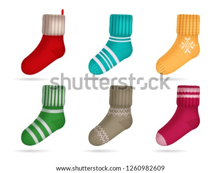 Winter knitted bright colored socks realistic set isolated vector illustration