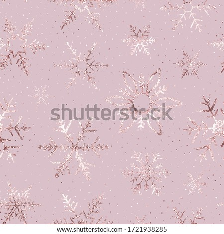 Winter marble foil seamless pattern. Snowflakes rose gold. Marble winter texture roses golden. Background snow flake. Snowflake for winter design. Metallic effect foil. Falling scatter gold snowflakes