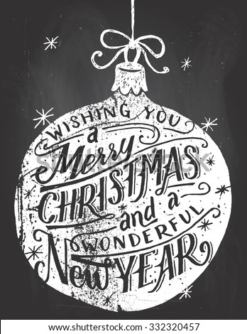 Wishing you a Merry Christmas and a wonderful New Year. Hand lettered quote inside a Christmas ball on blackboard background with chalk