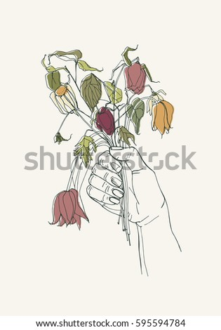 withered flowers in her hand