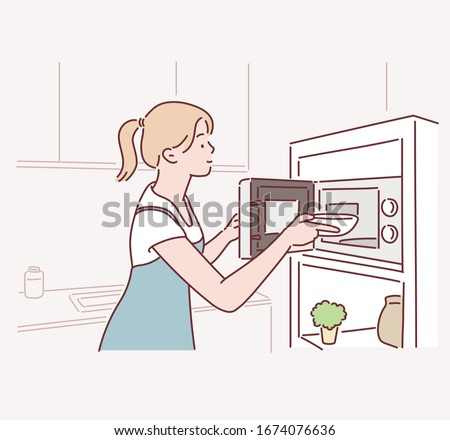 Woman cooking with a microwave in a modern kitchen. Hand drawn style vector design illustrations.