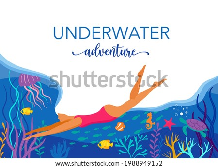 woman diving with wild marine