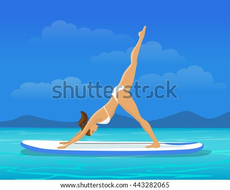woman doing stand up paddling