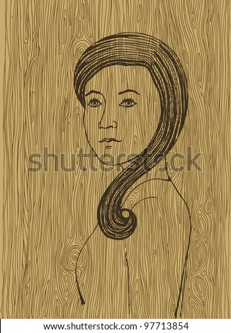 Woman face on the wooden texture
