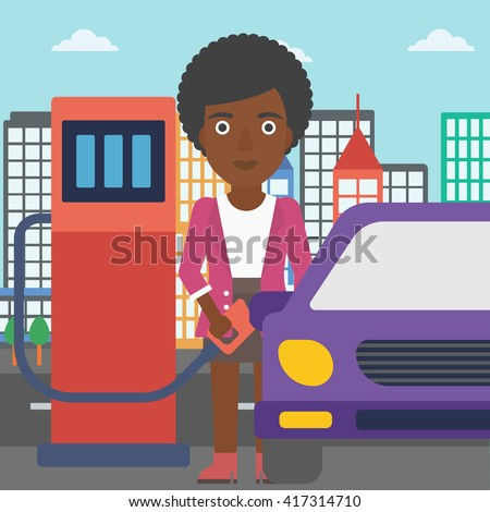 woman filling up fuel into car