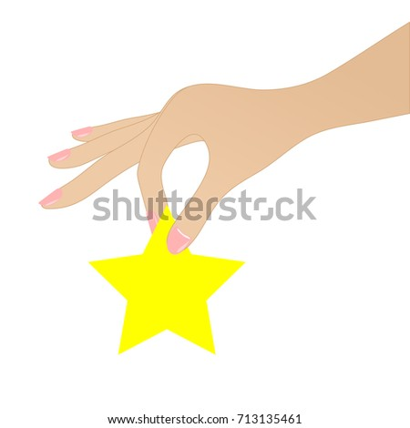 woman hand holds yellow star on