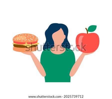 woman hold hamburger and apple