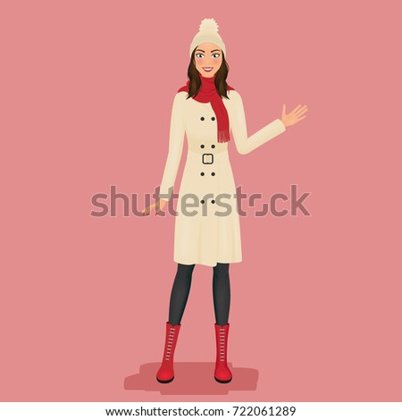 woman in a coat  pom pom hat