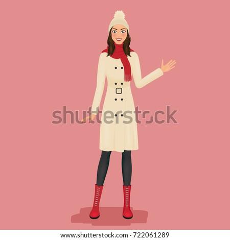 woman in a coat  pom pom hat