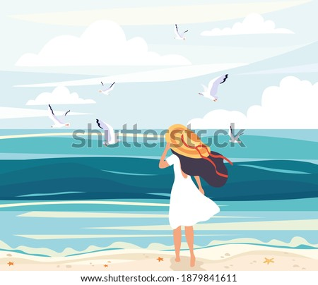 woman in a straw sunhat at the