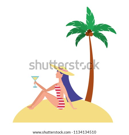 woman in swimsuit with cocktail on beach