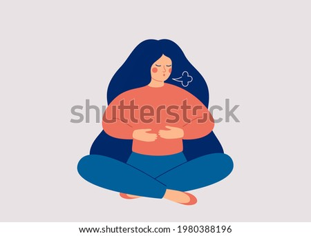 Woman makes Breathing exercise. Girl sits on the floor in pose lotus and makes a exhale. Recovery Respiratory system after illness. Health and wellbeing concept.  Photo stock ©