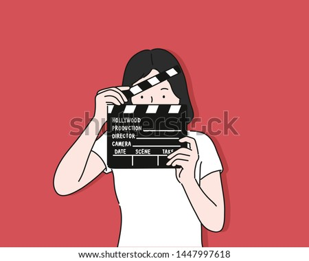 woman portrait holding movie