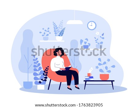 woman reading book in home