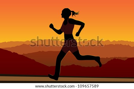 Woman running at sunrise/sunset