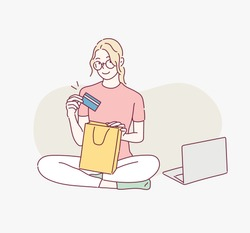 Woman shopping online on laptop. Hand drawn style vector design illustrations.