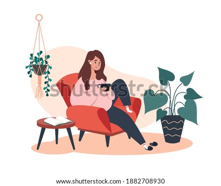 Woman sitting and resting on an armchair with coffee, rest at home Foto stock ©