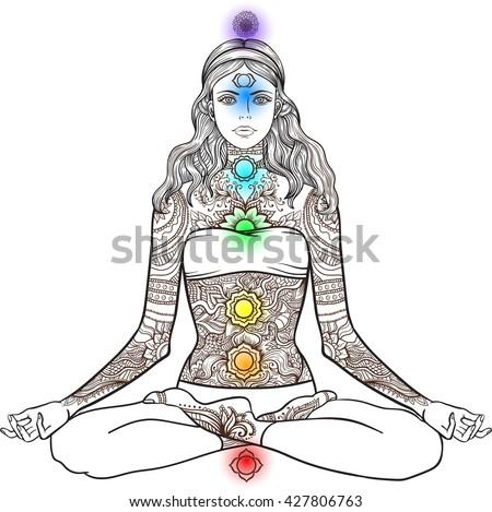 woman sitting in yoga lotus pose with tattoo mehndi