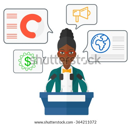 woman speaking on podium