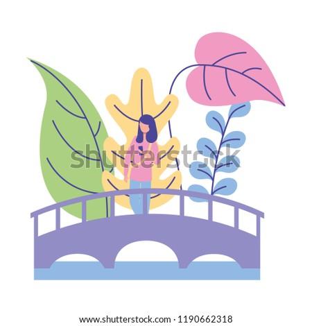 woman standing on the bridge nature plants