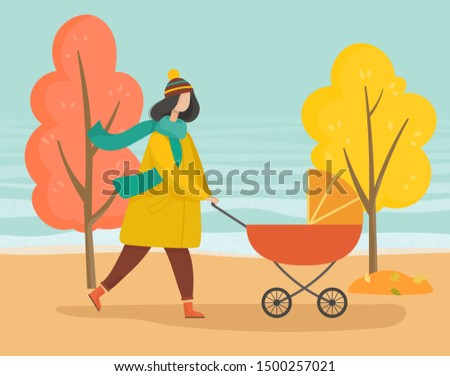 woman strolling with baby pram