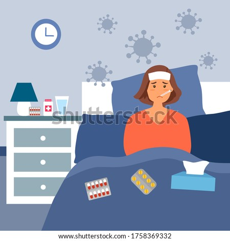 Woman suffering from flu in bed under blanket. She has fever and take thermometer in mouth with tissue paper and medicine on bed.  Flu or cold allergy symptom.  Corona virus influenza infection.