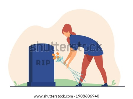 woman visiting relatives grave
