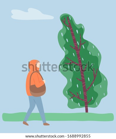 woman walking in park alone