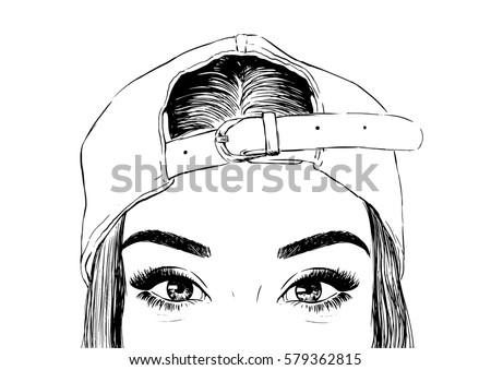 woman wearing cap backwards