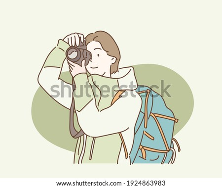 woman with backpack taking a photo. Hand drawn style vector design illustrations.