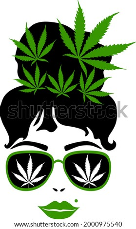 woman with cannabis leafs in