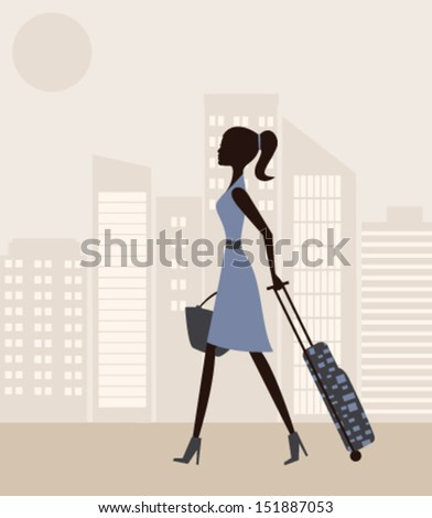 woman with suitcase in the city