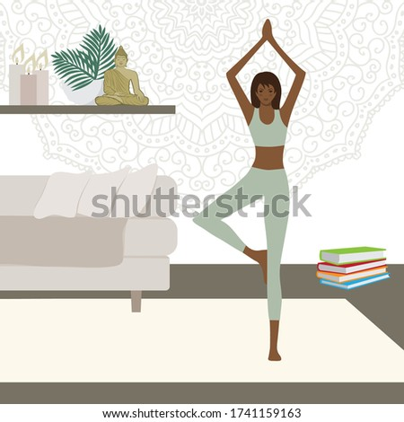 woman yoga tree pose inside her
