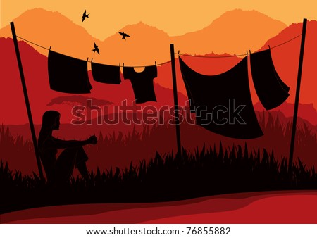 Women drying clothes in wild africa landscape