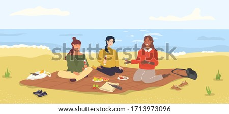 women friends have a picnic on