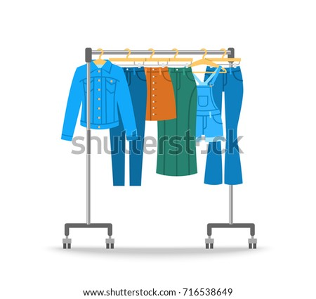 Women jean clothes hanging on hanger rack with rolling wheels. Vector flat illustration. New cotton collection. Trendy season wear. Jeans, jacket, skirts and jumpsuit shorts for stylish girl wardrobe.