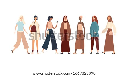 Women of various races and cultures. Group of multiracial and multicultural ladies in stylish modern and traditional outfits standing in line and representing unity and globalization