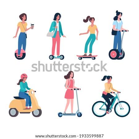 women ride modern electric